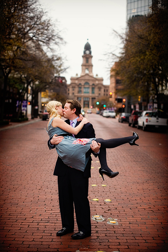 engagement portraits in downtown fort worth with the courthouse in the back