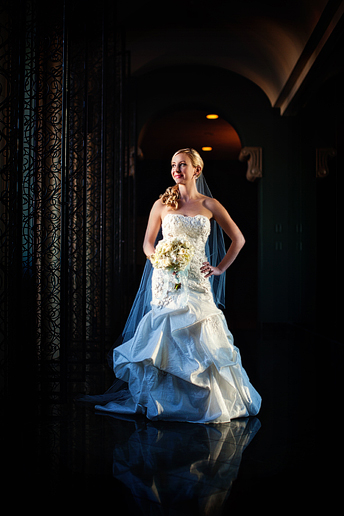 beautiful bridal portraits at the Fort Worth Club in the mirror hallway
