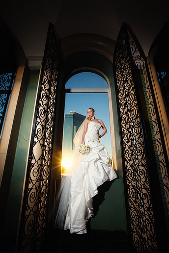 awesome bridal portraits in a window at the Fort Worth Club by Dallas wedding photographer Allison Davis Photography