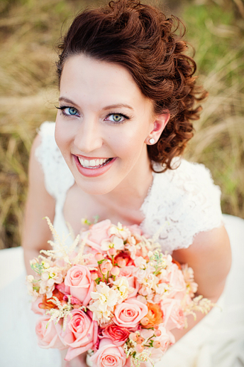 bridal portrait in a wild field with tall grass near white rock lake by dallas wedding photographer