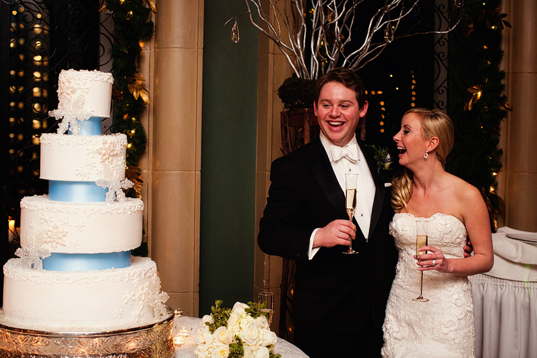 cake cutting at the fort worth club at a wedding reception