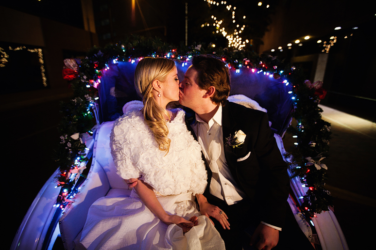 winter wedding exit in a horse-drawn carriage in downtown fort worth